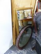 A LARGE EDWARDIAN OVAL MIRROR, AND A GILT FRAMED WALL MIRROR.
