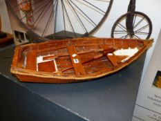 A MODEL ROWBOAT WITH CLINKER HULL 75 CM LONG