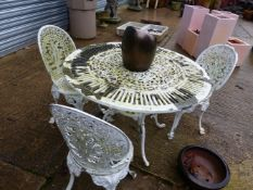 A WHITE PAINTED ALLOY PATIO TABLE AND THREE CHAIRS