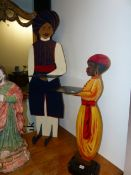 TWO PAINTED EASTERN FIGURES HOLDING TRAYS AS SILENT BUTLERS/ DUMB WAITERS TALLEST 120 CM HIGH