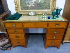 AN ANTIQUE MAHOGANY AND BRASS BOUND CAMPAIGN TYPE PEDESTAL DESK.