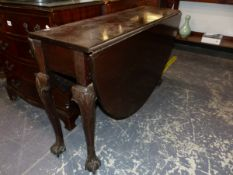 A 19th C. MAHOGANY OVAL FLAP TOP TABLE WITH CABRIOLE LEGS ON BALL AND CLAW FEET. W 113 x D 36 CLOSED