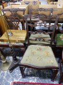 A PAIR OF GEORGIAN STYLE LADDER BACK DINING CHAIRS AND A FURTHER CHAIR ON CARVED CABRIOLE LEGS