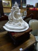 A VICTORIAN ROSE WOOD FOOT STOOL, AND A CARVED WALL BRACKET.