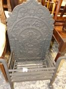 AN ANTIQUE IRON FIRE GRATE WITH CAST IRON BACK.
