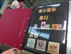A STOCK BOOK ALBUM OF AUSTRALIA STAMPS AND COVERS.