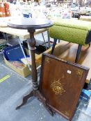 A EDWARDIAN DECORATED TEA TRAY AND A TRIPOD TORCHERE.