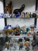 A LARGE COLLECTION OF VINTAGE GLASS, CERAMIC, METAL AND OTHER DECORATIVE ELEPHANT ORNAMENTS.