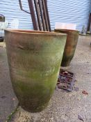A PAIR OF TALL TERRACOTTA PLANTERS