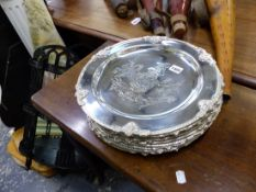 TEN SMALL SILVER PLATED ARMORIAL PLATTERS.
