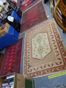 A TURKISH RUG 174 X 120 TOGETHER WITH TWO OTHERS OF BOKHARA DESIGN