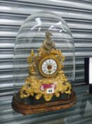 A VICTORIAN GILT METAL MANTEL CLOCK ON PLINTH BASE.