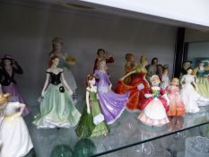 SEVENTEEN VARIOUS DOULTON, COALPORT AND WORCESTER FIGURINES AND A STAFFORSHIRE FIGURINE