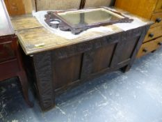 AN 18th C. OAK PANEL FRONT COFFER.