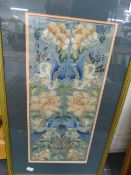 A PAIR OF CHINESE SILK WORK FRAMED SLEEVE BANDS.