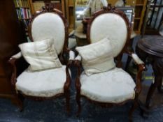 A PAIR OF VICTORIAN STYLE SHOW FRAME SALON ARM CHAIRS.
