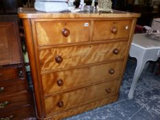 A VICTORIAN SATIN BIRCH CHEST OF TWO SHORT AND THREE LONG GRADUATED DRAWERS.