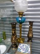 A VINTAGE OIL LAMP, TWO EASTERN ETCHED BRASS VASES, AND A VICTORIAN TEA POT STAND.