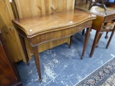 A GEORGIAN MAHOGANY INLAID SERPENTINE FOLD OVER CARD TABLE ON FLUTED SQUARE LEGS, TOGETHER WITH A