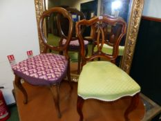 TWO VICTORIAN CARVED WALNUT CHAIRS WITH CABRIOLE LEGS