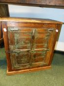 AN EASTERN IRON MOUNTED AND PAINTED SMALL RUSTIC CABINET