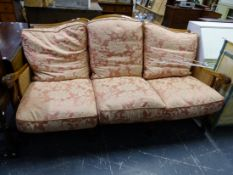 A LARGE BERGERE THREE SEAT SETTEE.