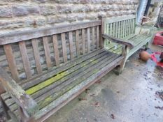 A NEAR PAIR OF LARGE GARDEN BENCHES.