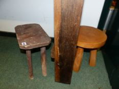 A RUSTIC LOW STOOL AND ONE OTHER