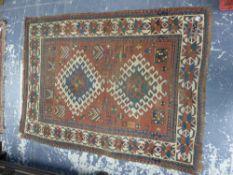 AN ANTIQUE CAUCASIAN KAZAK RUG, 174 X 129cms.