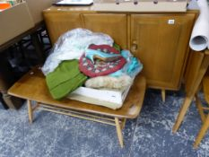 AN ERCOL DROP LEAF BREAKFAST TABLE, AN ERCOL THREE DOOR SIDEBOARD, AN ERCOL COFFEE TABLE TOGETHER