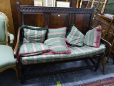 AN 18th C. OAK HALL SETTLE, WITH THREE PANEL BACK.