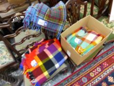 THREE WITNEY WOOL BLANKETS IN VARIOUS COLOURS.