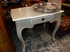 A FRENCH STYLE PAINTED SIDE TABLE.
