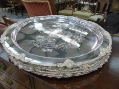 SIX LARGE ARMORIAL ENGRAVED SILVER PLATED PLATTERS.