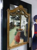 A FRENCH STYLE CARVED AND GILT FRAMED MIRROR WITH SWAG DECORATION 70 X 110 CM