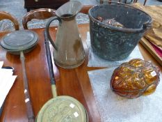 A LARGE BRASS BUCKET, COPPER EWER, A PAIR OF ORANGE GLASS LIGHT SHADES AND TWO WARMING PANS.
