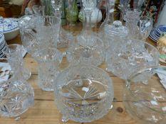 A QUANTITY OF CUT GLASS BOWLS, DECANTERS, VASES ETC.