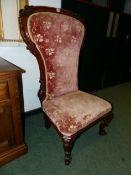 A VICTORIAN CARVED ROSEWOOD SHOWFRAME SLIPPER CHAIR