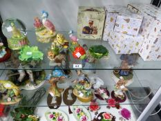 A COLLECTION OF BEATRIX POTTER FIGURES AND CERAMICS TO INCLUDE , DOULTON , BORDER FINE ARTS AND