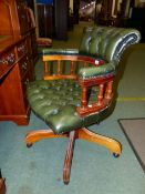 A BUTTON GREEN LEATHER UPHOLSTERED OFFICE SWIVEL ARMCHAIR