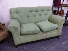 A LATE VICTORIAN DROP END BUTTON BACK SETTEE.