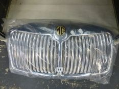 A VINTAGE MG MGA CHROME RADIATOR GRILL.