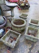 FOUR CONCRETE PLANTERS, A WELL TOP AND BIRD BATH.
