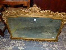 A GILDED FRAME DECORATIVE WALL MIRROR.