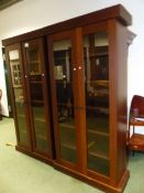 A PAIR OF CONTEMPORARY TALL GLAZED DISPLAY BOOKCASES EACH 110 CM WIDE X 220 CM HIGH