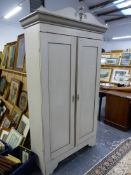 A PAINTED TWO DOOR HALL CABINET.