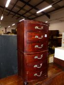A MINIATURE CHEST OF SIX DRAWERS.