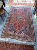 AN ANTIQUE PERSIAN QASHQAI RUG, 250 X 148cms.