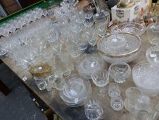AN EXTENSIVE COLLECTION OF DRINKING GLASSES, DECANTERS, BOWLS CUT GLASS ETC.