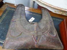 A MAASAI BEADED LEATHER BAG OR GRIS-GRIS. 50 x 44cms.